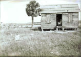 African-American woman in doorway of cabin