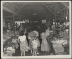 Assembly Street, stalls and buyers under shed; Food Stamp signs, 1946