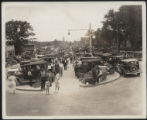 Looking up Assembly Street from State House Grounds, cars lined up, girls in foreground, 1934