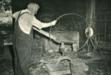 Blacksmith working on wagon tie