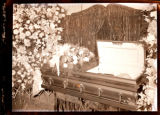 Lotis Funeral. September 1, 1950. Body in coffin surrounded by flowers.